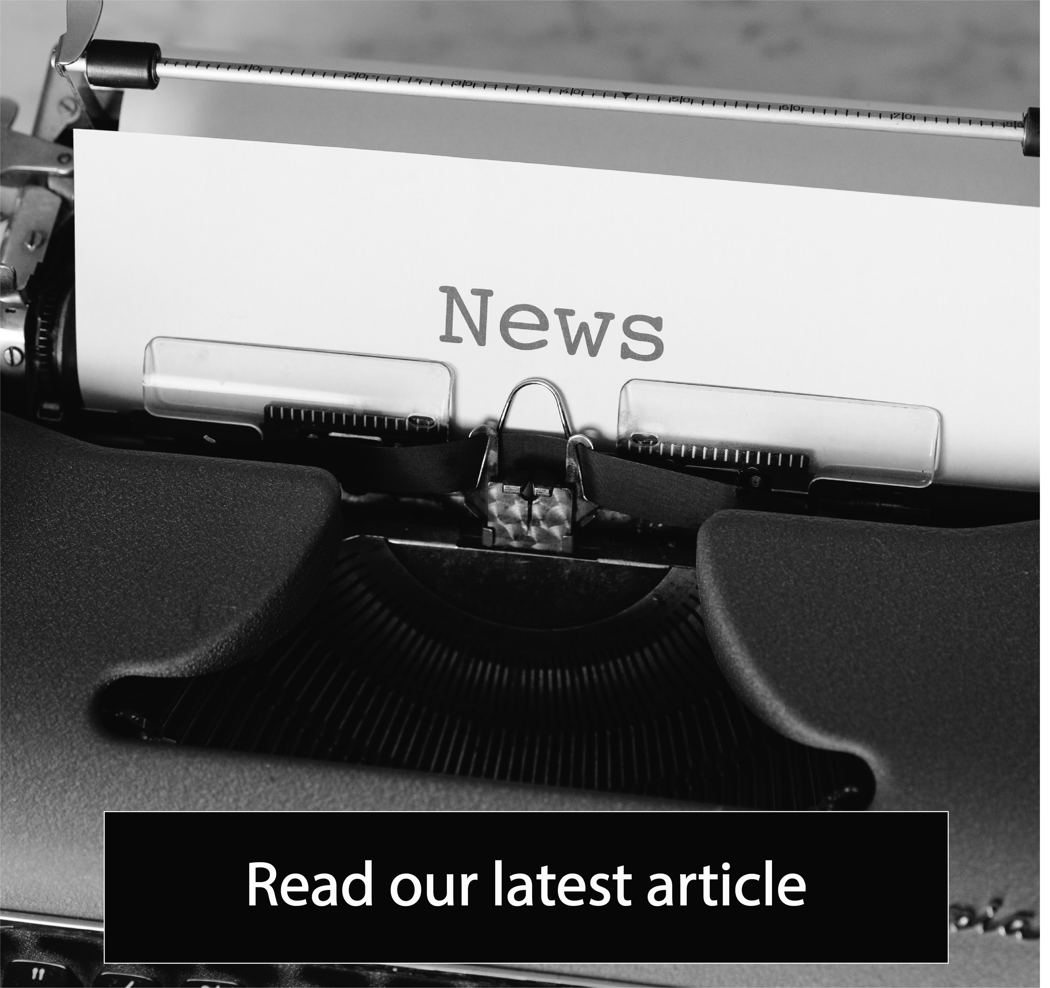 Typewritter photo + 'read our latest article' button